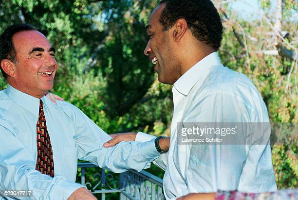 Simpson after his acquittal, at home in Brentwood greeting his attorney, Robert Shapiro.