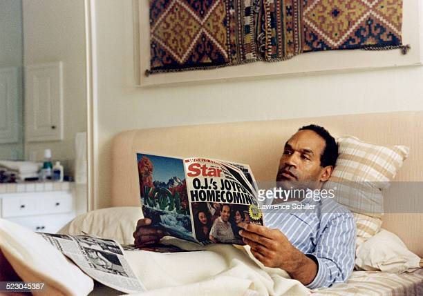 Simpson after his acquittal, at home in Brentwood reading a recent issue of the Globe with the photos of his homecoming.
