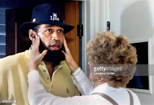 J Simpson after his acquittal having a disguise applied to his face so that he can go outside of his home unnoticed