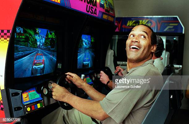 J Simpson after his acquittal playing with one of his children's arcade games at his home in Brentwood