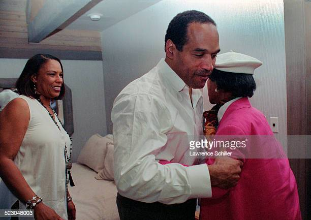 J Simpson after his acquittal with his mother Eunice on right and his former wife Marguerite on left