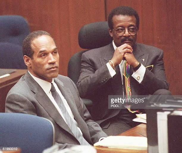 J Simpson and attorney Johnnie Cochran Jr listen to Judge Lance Ito moments after the prosecution rested its case during Simpson's murder trial 06...