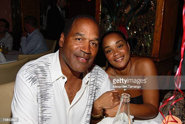 J Simpson and daughter Arnelle Simpson pose at the Forge restaurant during DJ Irie's birthday celebration on June 20 2007 in Miami Beach Florida
