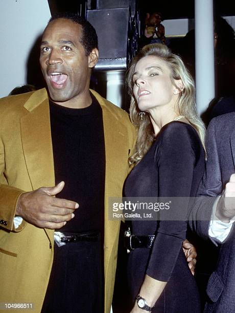 OJ Simpson and Nichole Simpson during Grand Opening of The Harley Davidson Cafe at Harley Davidson Cafe in New York City New York United States