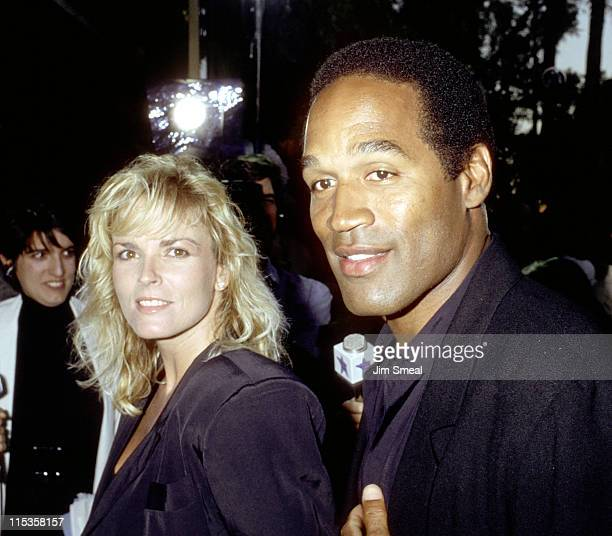 OJ Simpson and Nicole Brown Simpson during Premiere of When Harry Met Sally at Academy Theater in Los Angeles California United States