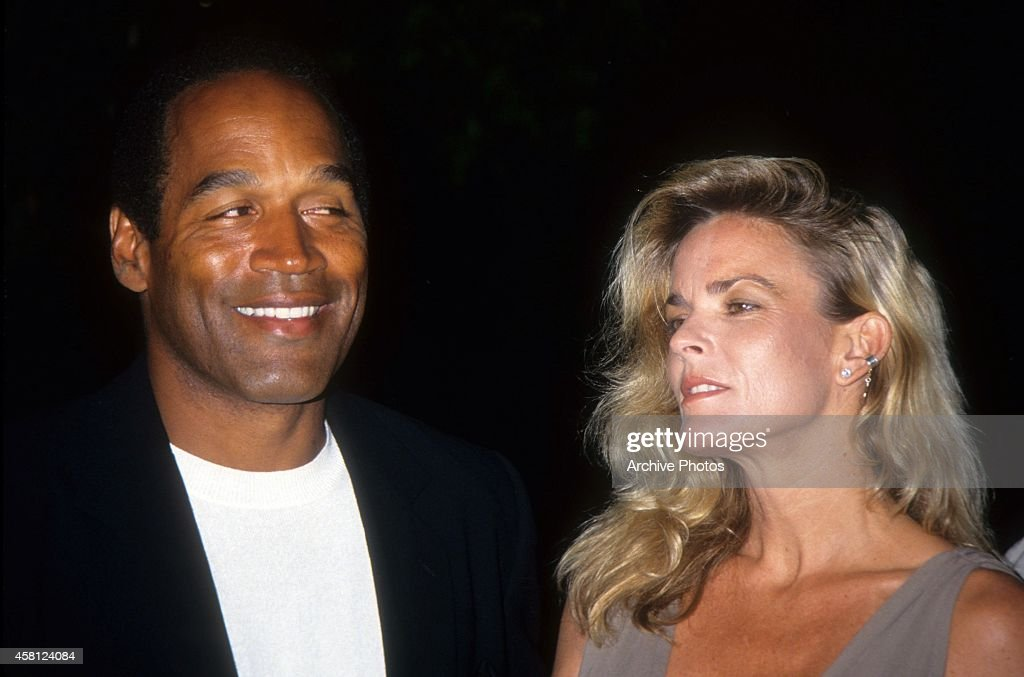 O.J. Simpson and Nicole Brown Simpson pose at the premiere