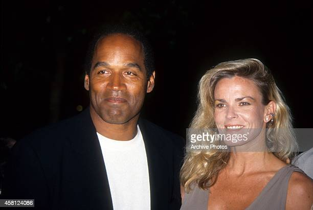 J Simpson and Nicole Brown Simpson pose at the premiere of the Naked Gun 33 1/3 The Final Isult in which OJ starred on March 16 1994 in Los Angeles...