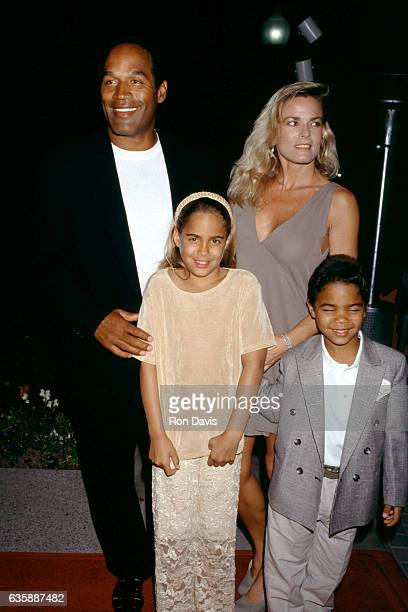 J Simpson and Nicole Brown Simpson walk the red carpet with their children Sydney and Justin as they attend the Naked Gun 33 1/3 The Final Insult...