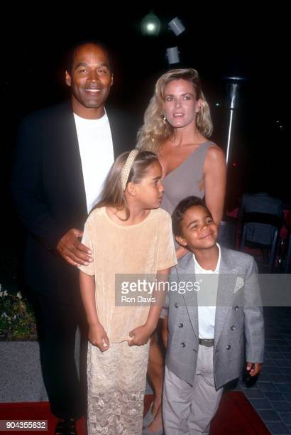 J Simpson and Nicole Brown Simpson walk the red carpet with their children Sydney and Justin as they attend the 'Naked Gun 33 1/3 The Final Insult'...