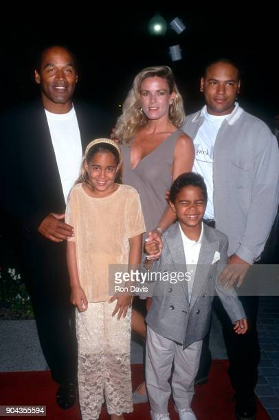 J Simpson and Nicole Brown Simpson walk the red carpet with their children Jason Simpson Sydney and Justin as they attend the 'Naked Gun 33 1/3 The...