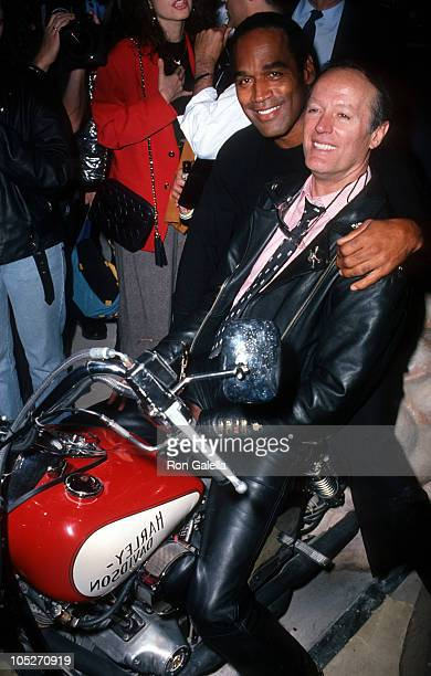 OJ Simpson and Peter Fonda during Grand Opening of The Harley Davidson Cafe at Harley Davidson Cafe in New York City New York United States