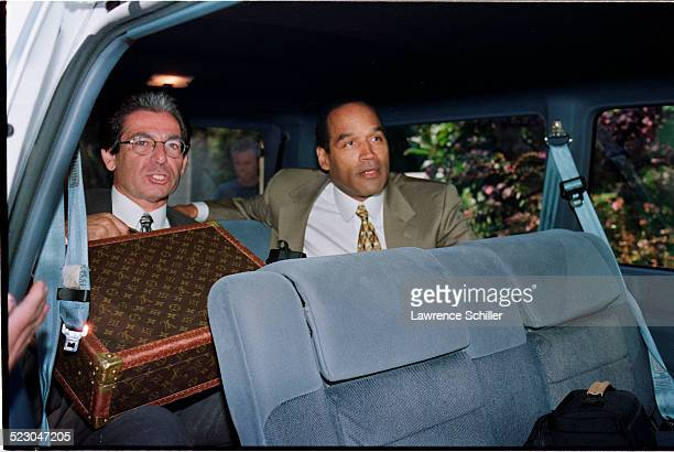 J Simpson arriving at his home in Brentwood after his acquittal with Robert Kardashian on the left