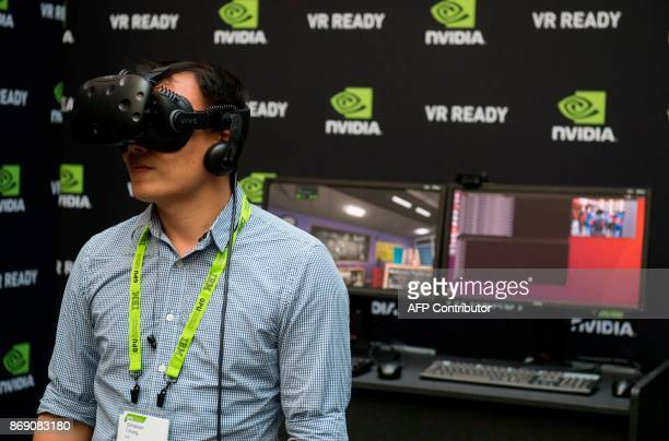 Simpson Chung uses a virtual reality headset during the NVIDIA GPU Technology Conference which showcases artificial intelligence deep learning...