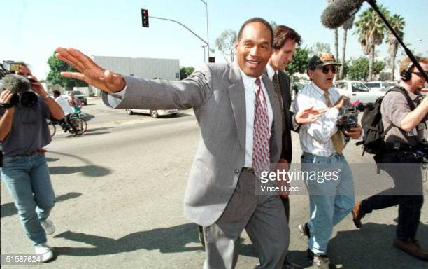 J Simpson crosses the street from the courthouse in Santa Monica California during a lunch break 23 October on the first day of his trial in the...