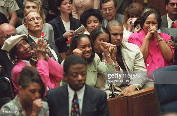 Simpson family members celebrate the not guilty verdicts in the murder trial of O.J. Simpson 03 October in Los Angeles. From left to right are...