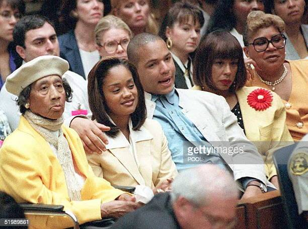 Simpson family members sit in court during a brief hearing 10 July prior to the defense calling its first witness in the O.J. Simpson double-murder...