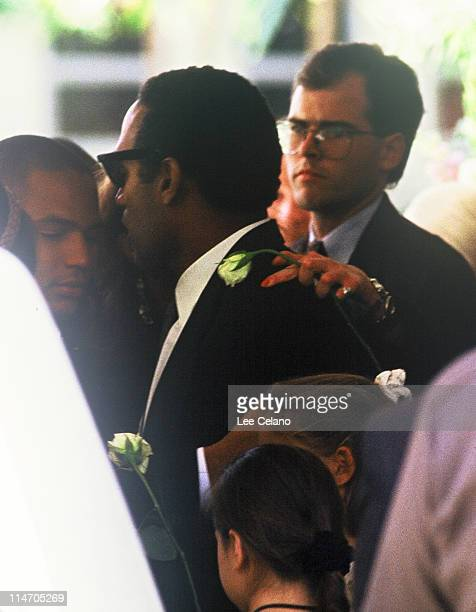 OJ Simpson is shown with family members as he departs the funeral for his exwife Nicole Brown Simpson June 16 1994