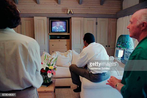 J Simpson just hours after his acquittal watching a replay of the verdict on TV
