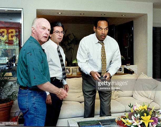 O.J. Simpson, just hours after his acquittal watching a replay of the verdict on TV with Robert Kardashian on his right (our left).