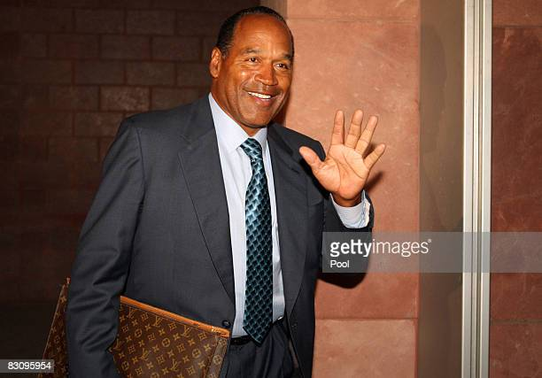 J Simpson leaves court after closing arguments for his trial at the Clark County Regional Justice Center on October 2 2008 in Las Vegas Nevada...