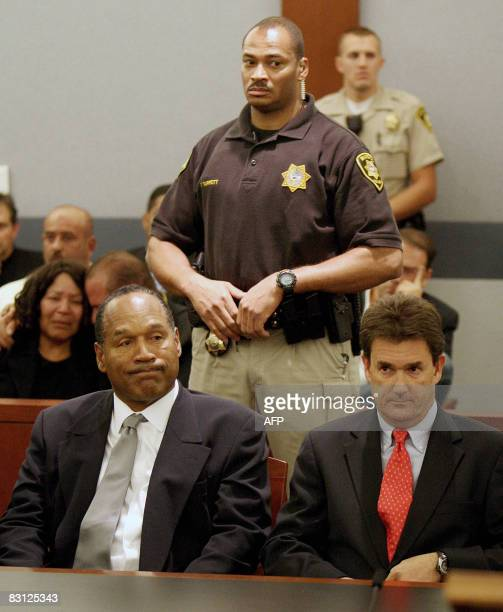 OJ Simpson left and his attorney Yale Galanter right listen as Simpson is found guilty on all 12 charges including felony kidnapping armed robbery...