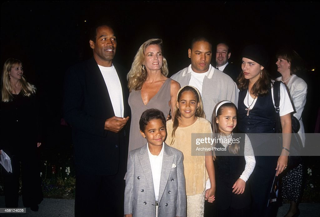 O.J. Simpson, Nicole Brown Simpson, Jason Simpson, Sydney Brooke Simpson, Justin Ryan Simpson pose at the premiere of the 'Naked Gun 33 1/3: The Final Isult' in which O.J. starred on March 16, 1994 in Los Angeles, California.