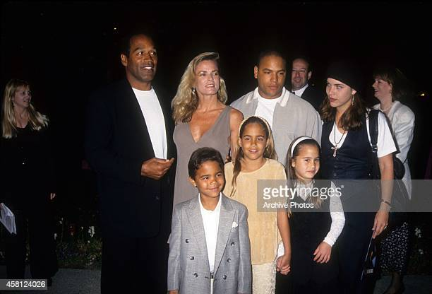 J Simpson Nicole Brown Simpson Jason Simpson Sydney Brooke Simpson Justin Ryan Simpson pose at the premiere of the Naked Gun 33 1/3 The Final Isult...
