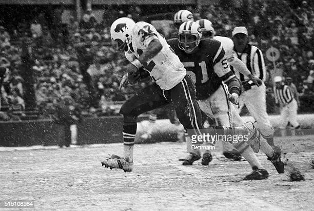 Simpson , of the Buffalo Bills, heads for the goal line on a 13-yard run in the second quarter against the NY Jets. Ralph Baker , of the Jets, is...