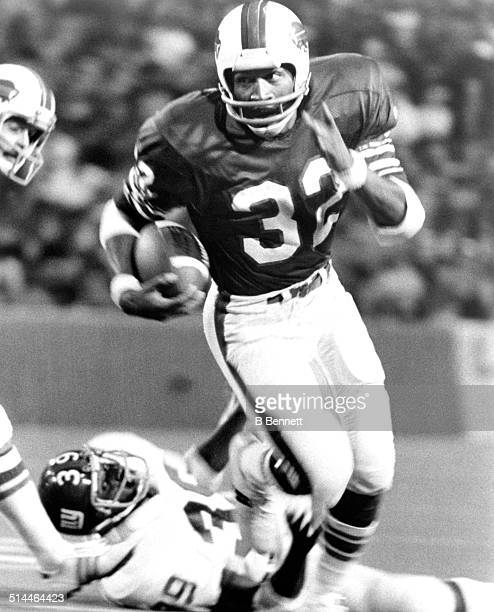 J Simpson of the Buffalo Bills runs with the ball during an NFL game against the New York Giants circa 1976 at Rich Stadium in Orchard Park New York