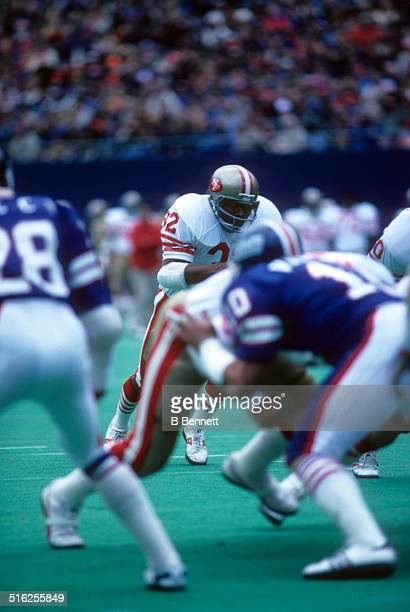 Simpson of the San Francisco 49ers runs with the ball during an NFL game against the New York Giants on October 14, 1979 at Giants Stadium in East...