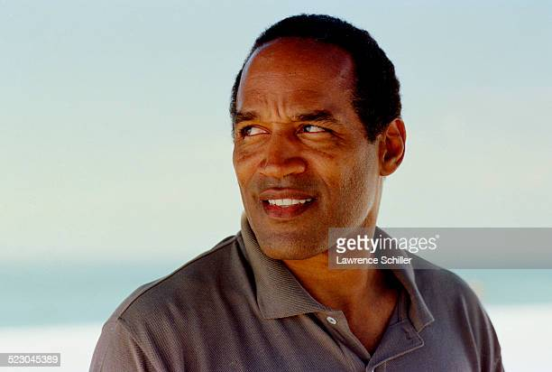 J Simpson on the beach in Florida weeks after his acquittal