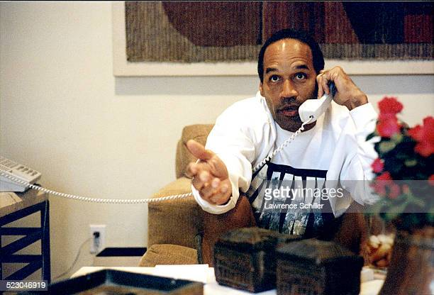 Simpson on the phone after his acquittal, at a hotel in Florida.
