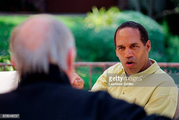 J Simpson outside his home the day after his acquittal discussing the case with his attorney Skip Taft