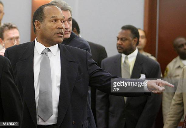 OJ Simpson points before a guilty verdict is read during his trial at the Clark County Regional Justice Center on October 3 2008 in Las Vegas Nevada...
