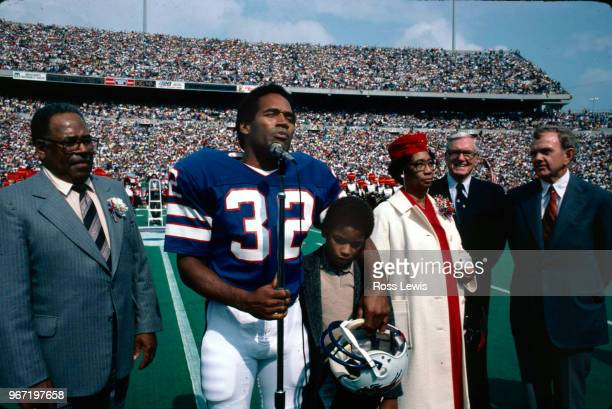 Simpson, professional football player with the Buffalo Bills, is inducted into the Wall of Fame in Rich Stadium on September 14, 1980. Simpson is...