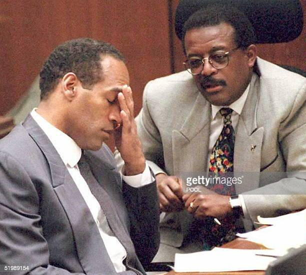 J Simpson reacts as a coroner describes the autopsy report on Nicole Brown Simpson in court 02 June in Los Angeles Prosecutors have begun the...
