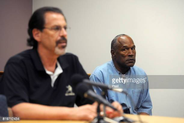 Simpson reacts during the testimony of Bruce Fromong during his parole hearing at Lovelock Correctional Center July 20, 2017 in Lovelock, Nevada....