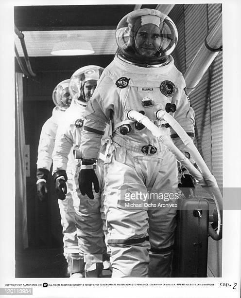 OJ Simpson Sam Waterston and James Brolin walking in full astronaut attire in a scene from the film 'Capricorn One' 1978
