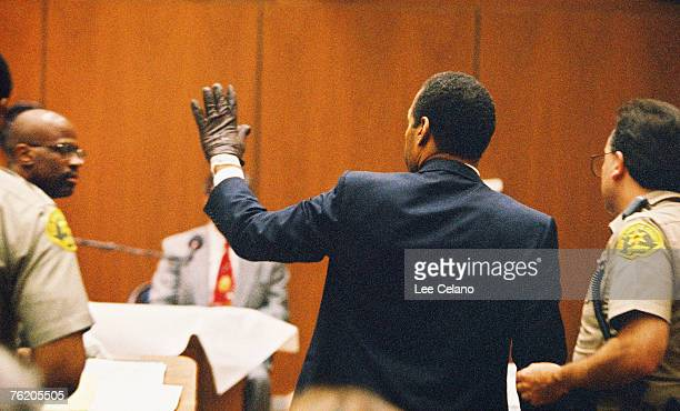 Simpson shows the judge a leather glove allegedly used in the murders of Nicole Brown Simpson and Ronald Goldman during testimony in Simpson's murder...
