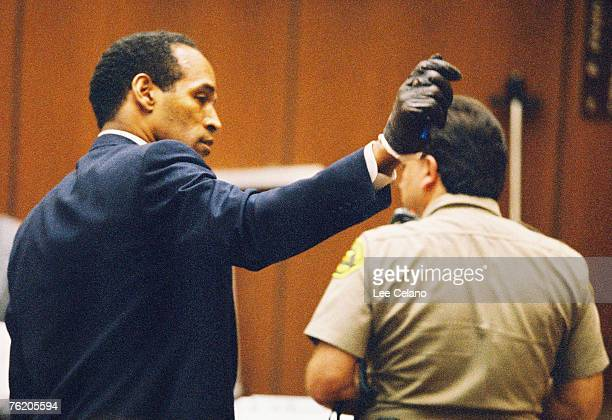 OJ Simpson shows the jury a leather glove allegedly used in the murders of Nicole Brown Simpson and Ronald Goldman during testimony in Simpson's...