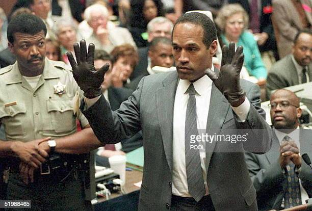 J Simpson shows the jury a new pair of Aris extralarge gloves similar to the gloves found at the Bundy and Rockingham crime scene 21 June during his...