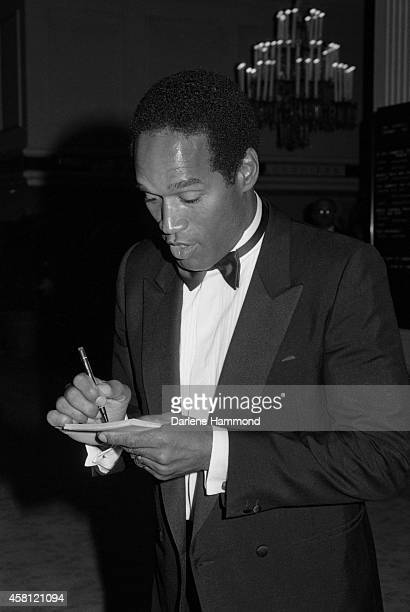 J Simpson signs an autograph during the United Cerebral Palsy Dinner on October 29 1988 at the Beverly Hilton Hotel in Los Angeles California