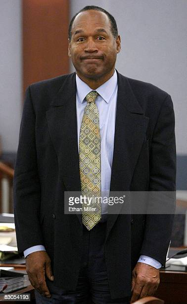 J Simpson stands in court during a break in his trial at the Clark County Regional Justice September 29 2008 in Las Vegas Nevada Simpson and...