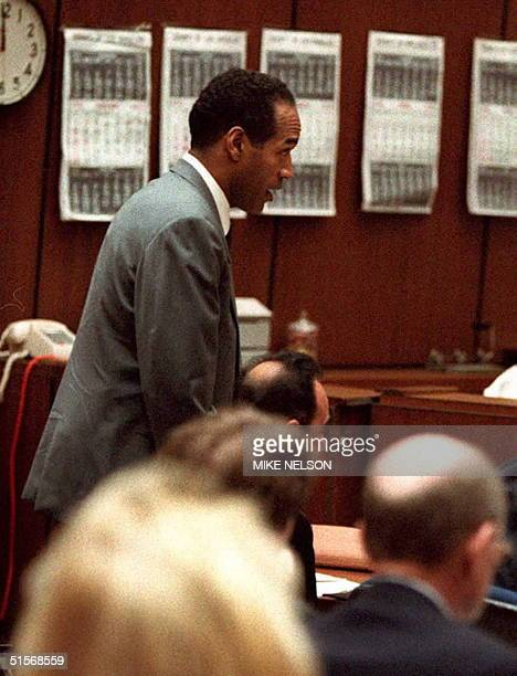 Simpson stands in court in Los Angeles 04 January during a hearing in which he said he understands the ramification of the legal tactics which deny...
