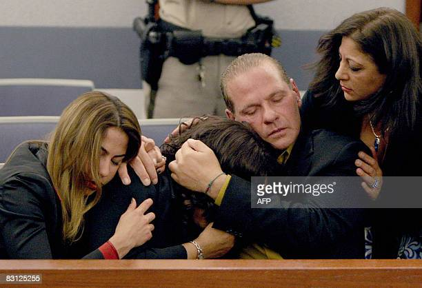 OJ Simpson supporters Sabrina Scotto his sister Carmelita Durio Tom Scotto and Sandra Scotto react as Simpson is found guilty on all 12 charges...