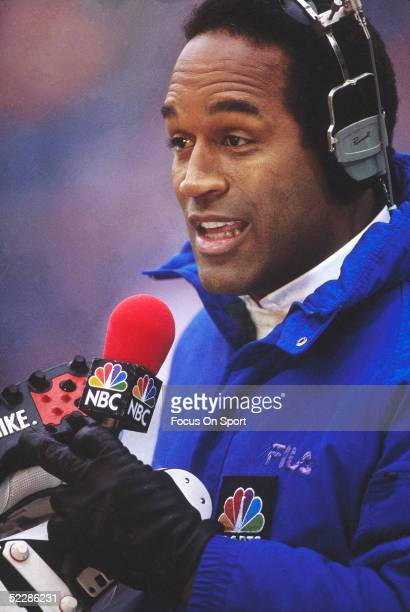J Simpson talks into a microphone during his career as a commentator for NBC Sports in 1990