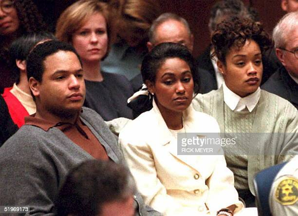 J Simpson's children from his first marriage Jason Arnelle and cousin Terri Baker appear in court 23 January in Los Angeles as the former football...