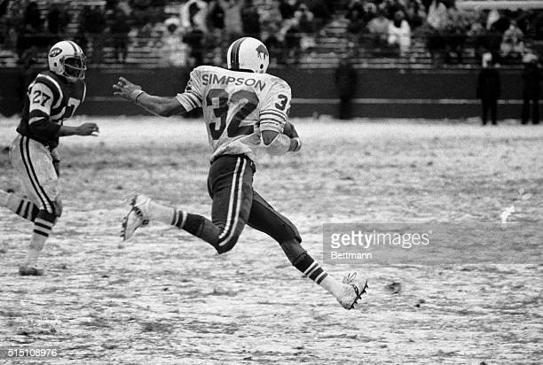 OJ Simpson's flying feet carry him to still another 200yard performance for a season total of 2003 yards He not only broke Jim Brown's single season...