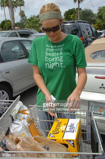J Simpson's girlfriend Christie Prody begins to load her car with groceries after shopping at Publix in the Krendal Mall on Saturday morning