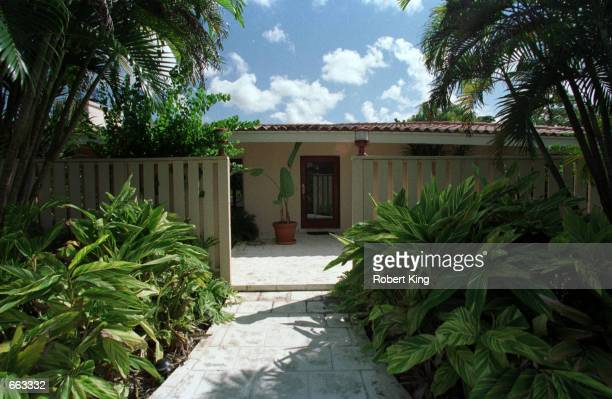 J Simpson's new $625000 house sits behind palm trees September 27 2000 in Miami The house has five bedrooms four baths a pool and guest house set on...